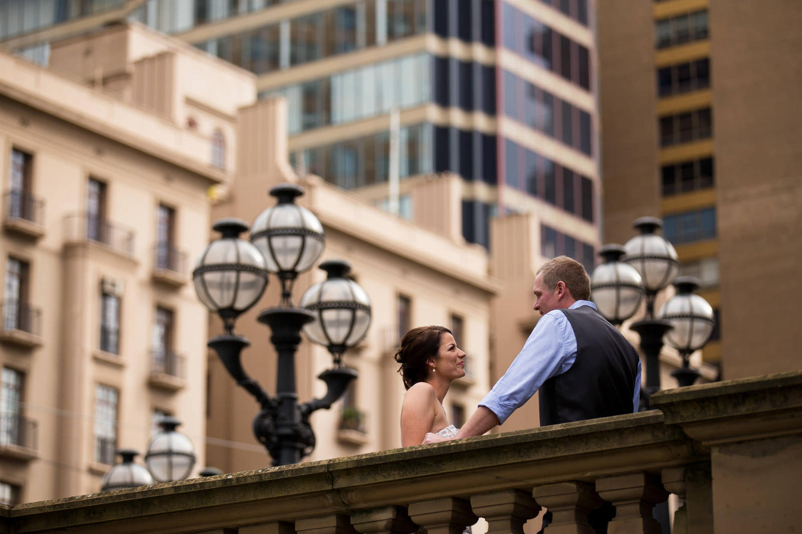 elopement photography melbourne couple starting into each other eyes with the city skyline in the distance